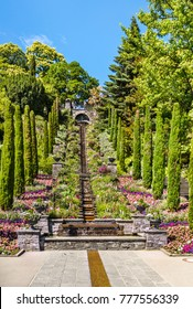 Germany, Mainau - June 21, 2012: Flower garden and a staircase with waterfall on the island of Mainau, Germany