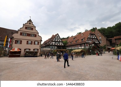 GERMANY, MAULBRONN - 22 JUNE 2019: Klosterhof Maulbronn with some sales booths and visitors of the Klosterfest 2019