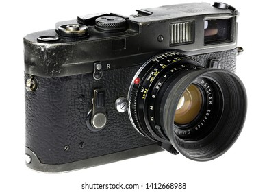GERMANY - MAY 25, 2019: Heavy used Leica M4 camera isolated on white background. The Leica M4 is a 35 mm rangefinder camera produced by Ernst Leitz GmbH from 1966 - 1975.