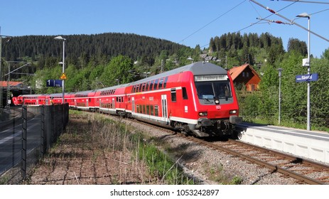Feldberg-Bärental / Germany - May 28 2017: The train station of Feldberg - Bärental in the Black Forest in Germany with a red double decker train of the DB