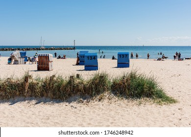 Eckernförde, Germany, May 30, 2020 - Pentecost season starts in Damp at the Eckernförde Bay in Schleswig-Holstein. A full marina and filled beaches with wonderful summer weather.