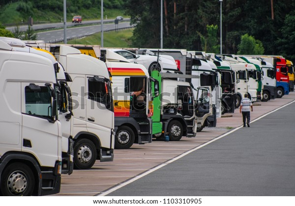 Germany - May, 31, 2018: Trucks on a parking near a highway in Germany
