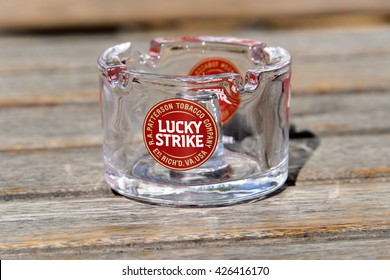 Germany, Munich: Glassy ashtray with famous Lucky Strike logo. Lucky Strike is a cigarette brand of British American Tobacco (BAT), the second largest tobacco group in the world. April 29, 2016