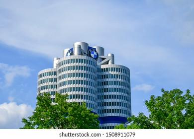 Germany, Munich - July, 2019:  BMW four-cylinder tower Munich landmark which serves as world headquarters for Bavarian automaker.The BMW Museum is an automobile museum of BMW history located near the