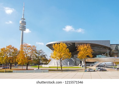 GERMANY / Munich - October 21, 2018: Picturesque autumn view on the famous exhibition center the BMW Welt and the Olympic Tower (Olympiaturm)