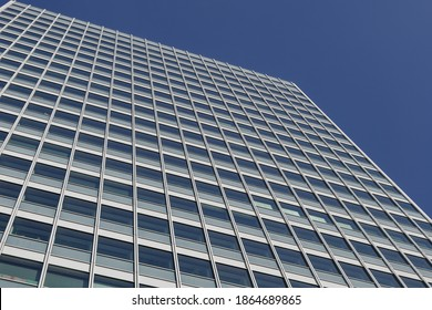 Düsseldorf, Germany - NOV 2020: Low angle view of Wirtschaft, iconic modern architecture with glass building's facade with rectangular windows frame structure system.