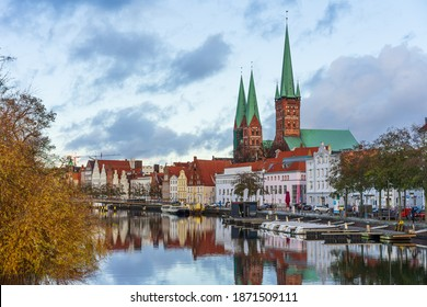Lübeck, Germany - November 26, 2020: City view of the northern german city Lübeck reflecting in the Trave.