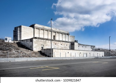 Germany, Nuremberg, Nazi party rally grounds, Zeppelin field: Side view of famous main tribune building stairs as part of the former German Reich Party Congress Grounds with new street signs.