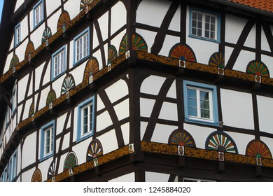 Osnabrück, Germany - October 30, 2011: Fragments of half-timbered black-and-white house decorated with colorful painting. Timber framing as traditional style of architecture. German Timber-Frame Road.