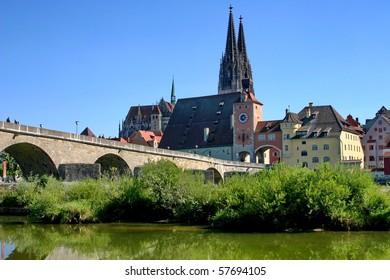 Germany. Old stone bridge across Danube in town Regensburg.