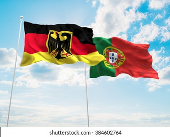 Germany & Portugal Flags are waving in the sky
