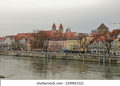 GERMANY, REGENSBURG, FEBRUARY 01, 2019: Cityscape of Regensburg with the river Danube,  Roman Tower and Niedermünster Abbey