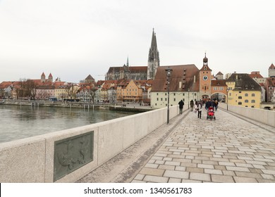 GERMANY, REGENSBURG, FEBRUARY 01, 2019: The Stone Bridge, Salzstadel, St. Peter' Cathedral, Roman Tower and Niedermünster Abbey at a glance