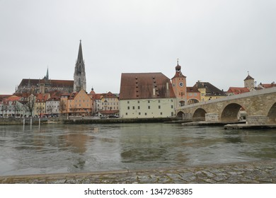GERMANY, REGENSBURG, FEBRUARY 01, 2019: Cityscape of Regensburg with Stone Bridge over Danube river, Salzstadel, Roman Tower, and St. Peter' Cathedral.