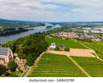 Germany, Rhineland-Palatinate. Bingen region, Kempen am Rhein, Rochusberg, view of Kempem on the Rhine, in the back Rudesheim, aerial view