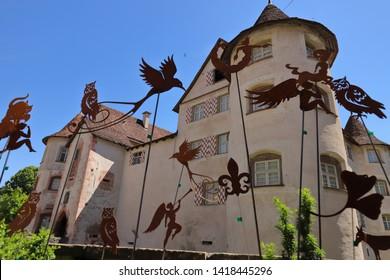 GERMANY, ROTTWEIL, SULZ AM NECKAR, GLATT, JUNE 02, 2019: Rusty metal figures in front of the moated castle