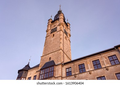 Germany, Saxony-Anhalt, Dessau-Rosslau: Facade of old city hall tower in late afternoon sunlight in the city center of the famous German town - concept administration government historic architecture