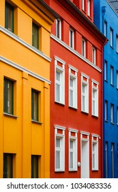 Germany street, facades, bright juicy colors. Red, blue, yellow.