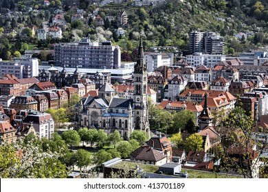 Germany, Stuttgart: Famous skyline panorama with buildings, smokestack, houses, red rooftops in the city center of the capital of Baden-Wuerttemberg. April 20, 2016