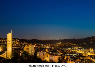 Germany, Stuttgart, Starry sky full of stars over skyline of houses of stuttgart city from above by night in summertime