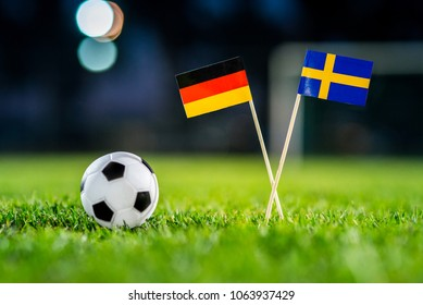 Germany - Sweden, Group F, Saturday, 23. June, Football, National Flags on green grass, white football ball on ground.