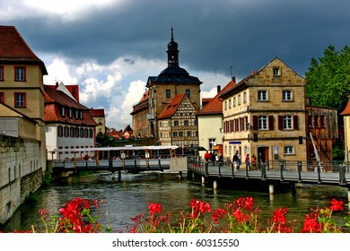 Germany. Tourists in old town on the stream.