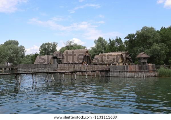 GERMANY, UNTERUHLDINGEN - JUNE 01, 2018: Reconstroctions of prehistoric pile dwellings on Lake Constance in the Pfahlbaumuseum Unteruhldingen