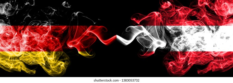 Germany vs Austria, Austrian smoky mystic flags placed side by side. Thick colored silky smoke flags of Deutschland and Austria, Austrian.