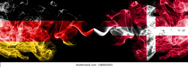 Germany vs Denmark, Danish smoky mystic flags placed side by side. Thick colored silky smoke flags of Deutschland and Denmark, Danish.