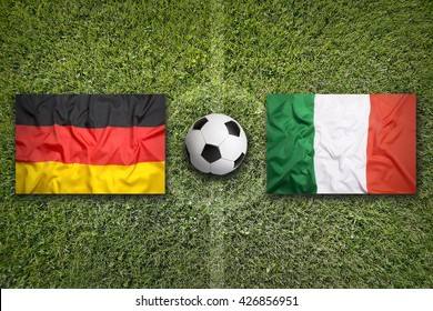 Germany vs. Italy flags on a green soccer field