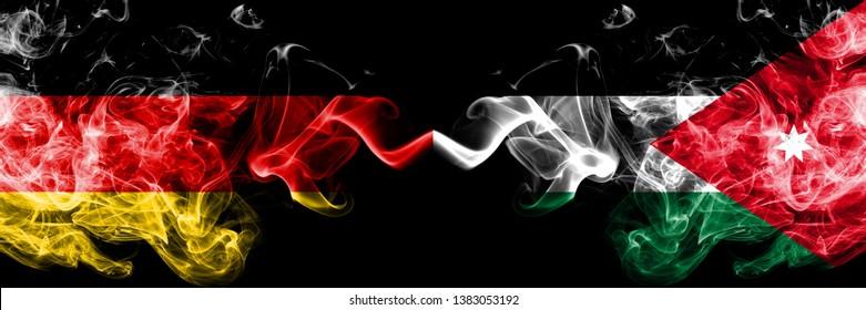 Germany vs Jordan, Jordanian smoky mystic flags placed side by side. Thick colored silky smoke flags of Deutschland and Jordan, Jordanian.