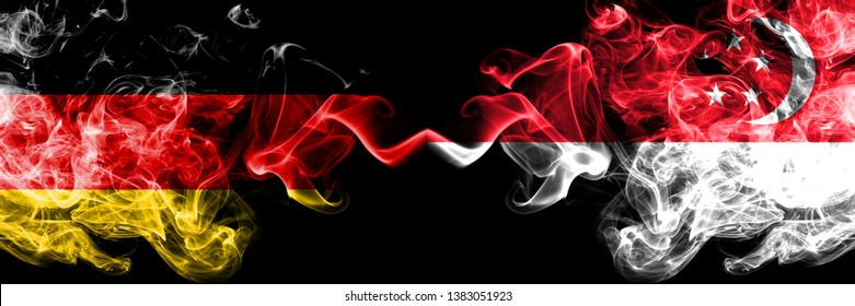 Germany vs Singapore, Singaporean smoky mystic flags placed side by side. Thick colored silky smoke flags of Deutschland and Singapore, Singaporean.
