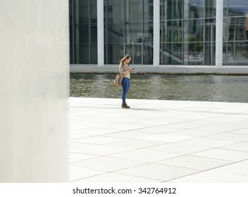 Germany, young woman with smartphone in Berlin