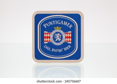 Germany,Berlin - January 7,2015:Beermat from Puntigamer beer on a glass table.Puntigamer is a Euro Pale Lager style beer brewed by Brauerei Puntigam  in Graz, Austria.