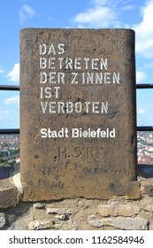 GERMANY,BIELEFELD-AUGUST 10, 2018: Age-old inscriptions carved on a stone tooth,ancient castle Sparrenburg.Warning label: entrance to the battlements is prohibited,city Bielefeld