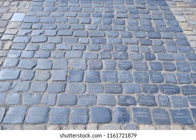 GERMANY,BIELEFELD-AUGUST 10, 2018: Stone place of cobblestones with the names of the benefactors,ancient castle Sparrenburg