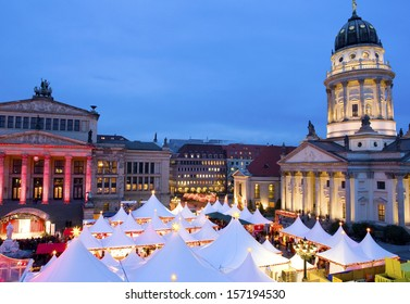 Germany/Capital Berlin. The very famous Christmas Market on the Gendarmenmarkt with the Schauspielhaus and the French Cathedral.