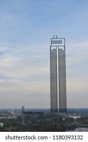 """GERMANY,COLOGNE-AUGUST 2, 2018: 45-storey skyscraper Colonia-Haus.Drawing on glass,sky background. Observation deck """"Panorama"""""""