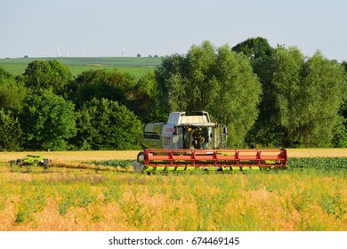 GERMANY-JULY 04: Harvester in the cereal field on July 04,2017 in Germany.