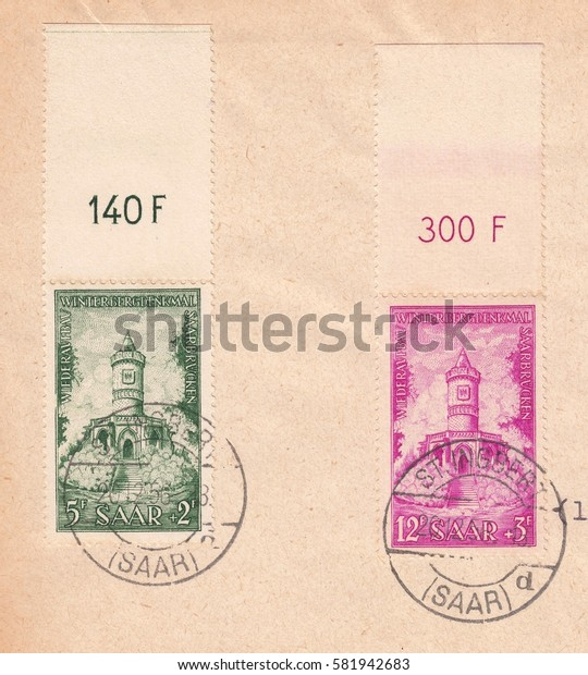 Germany,Saarland-CIRCA 1956:printed in Saar,shows charity stamps to raise money for the reconstruction of historical monuments of Winterberg in the memory of the Franco-Prussian war 1870,circa 1956