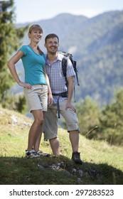 Germany,Upper Bavaria,Couple hiking,smiling