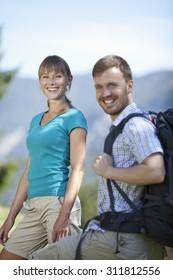 Germany,Upper Bavaria,Couple hiking,smiling,portrait