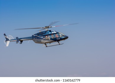 Germiston, South Africa - August 19, 2018: Bell 407 Helicopter display at the 2018 Rand Airshow
