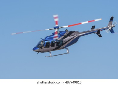 GERMISTON, SOUTH AFRICA-AUGUST 21 2016: A Bell 407 helicopter flies past at the Rand Airshow at Rand Airport.