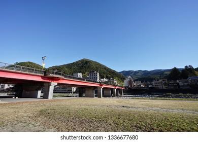 Gero Bridge across the Hida River in Gero Onsen, the famous onsen city in Gifu Prefecture, Japan.