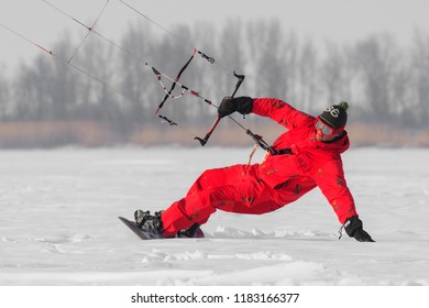 Geroimovka, Ukraine. March 6, 2018 Frosty morning. Red man is engaged in winter kiting
