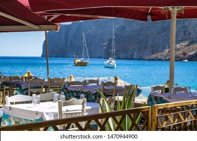 GEROLIMENAS, GREECE - AUGUST 2019: Beautiful scenery from the coastal village of Gerolimenas and the old harbor. It is a small picturesque fishing village in Mani peninsula, Laconia, Greece, Europe