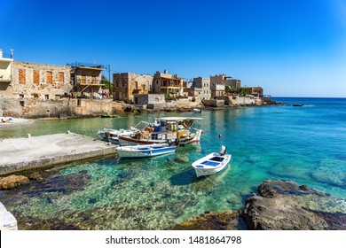 GEROLIMENAS, GREECE, AUGUST 2019: Beautiful scenery with traditional wooden fishing boats at the harbor of the coastal village Gerolimenas. Its a small picturesque village in Mani area, Laconia Greece