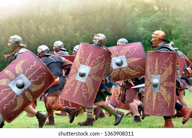 Gessate, Milan, Italy: April 07, 2019: reenactment of ancient Roman legionary soldiers during battle against Gallic army and life scene in war training camp