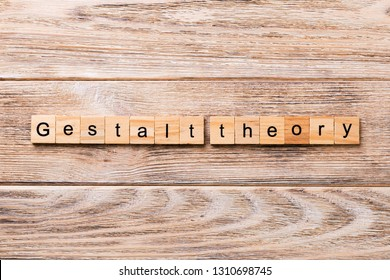 gestalt theory word written on wood block. gestalt theory text on wooden table for your desing, concept.